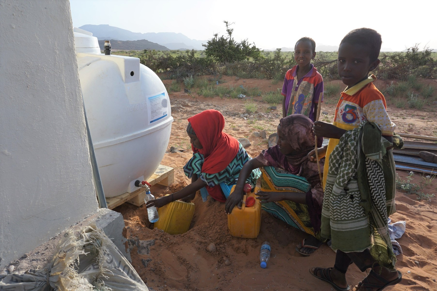Villagers with the water desinlation system in Beyo Gulan, Somaliland (Source Phaesun)